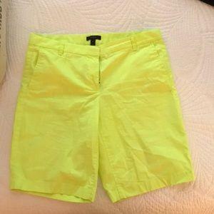 Bright neon yellow Bermuda shorts
